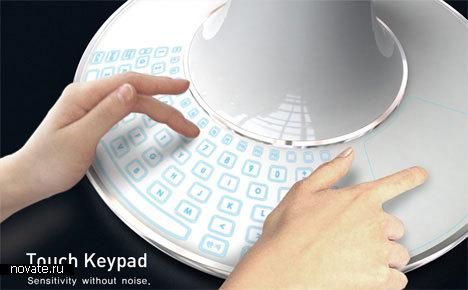 Компьютер в форме конуса с проектором вместо монитора