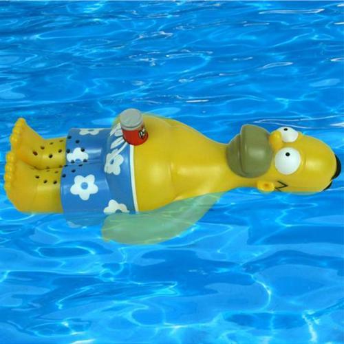 Радио Гомер Симпсон плавает на спине с банкой пива и поет в AM\FM диапозоне