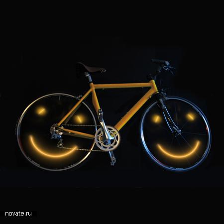 Улыбающийся колесами велосипед с устройством Joyrider