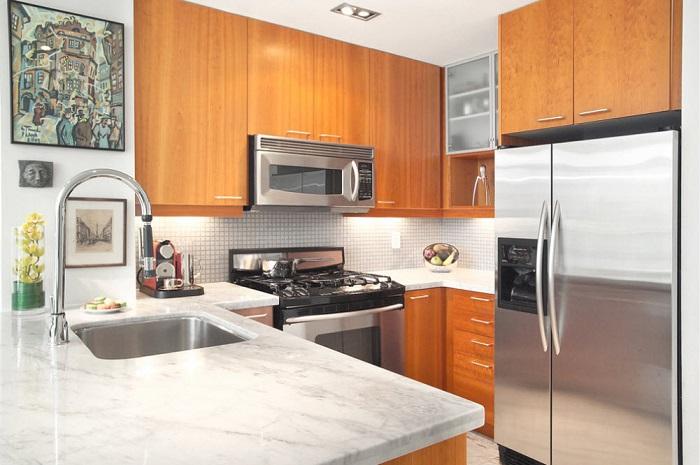 Нестандартное расположение шкафов поможет сэкономит много места на кухне