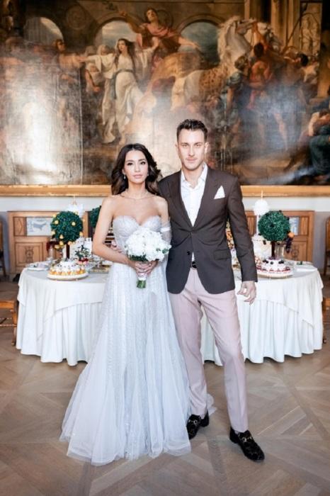 Мария Белова с мужем Александром Тарасовым, более известным, как T-killah. / Фото: hellomagazine.com