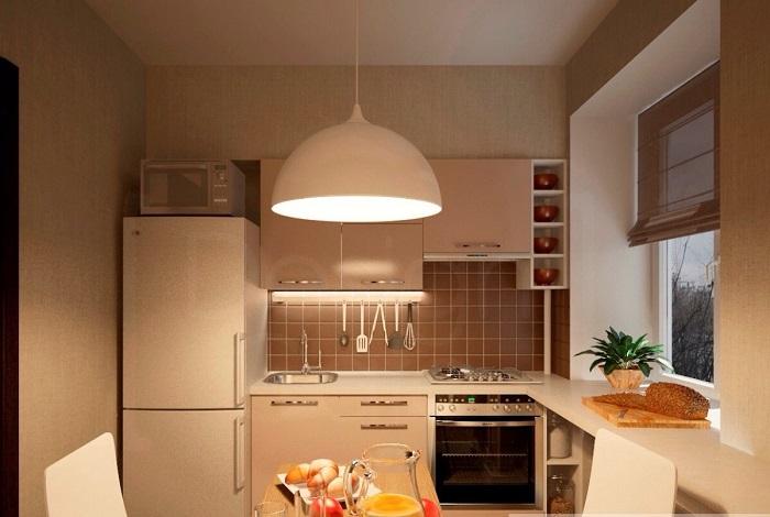 Освещение на кухне нужно и в рабочей зоне, и в обеденной. / Фото: design-homes.ru