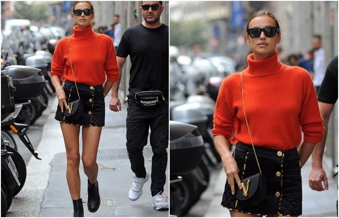 Объемный свитер прекрасно сочетается с короткой юбкой и массивными байкерскими ботинками