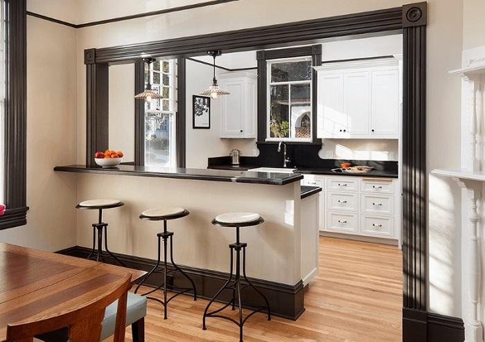 Барная стойка для зонирования пространства в квартире-студии. / Фото: dizainexpert.ru