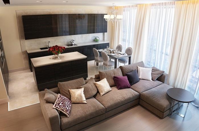 Кухню и гостиную разделяет диван. / Фото: acigaleclub.com