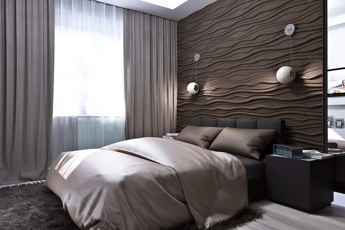 Акцентная стена из 3D-панелей в спальне. / Фото: noviydom.com.ua