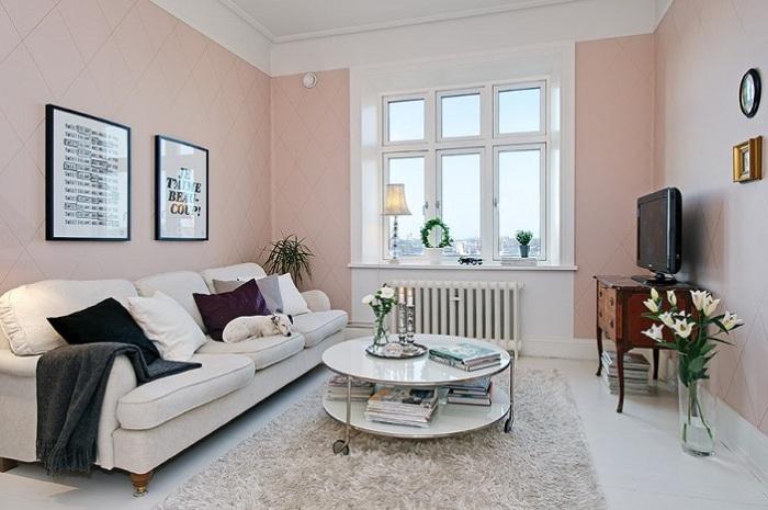 Нежно-розовые стены будут выполнять ту же задачу, что и белые - расширять пространство. / Фото: design-homes.ru