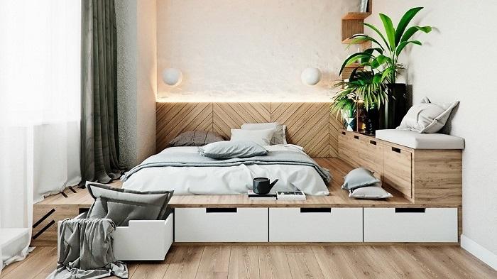 В подиуме можно спрятать ящики для хранения одежды. / Фото: flipboard.com