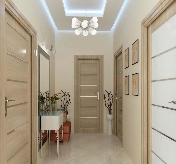 Сделать комнату визуально больше помогут светлые тона и мебель на ножках. / Фото: kolorit.ua