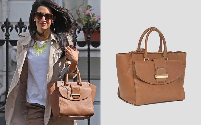 Амаль Клуни вместе с любимой сумкой, названной в ее честь. / Фото: peopletalk.ru