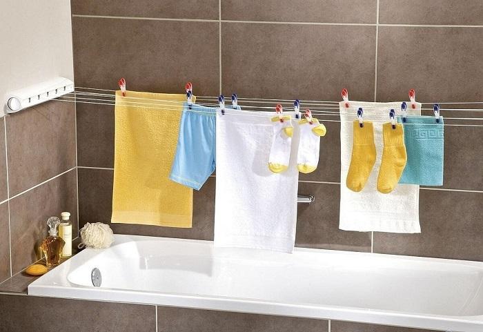 Оборудуйте сушилку над ванной. / Фото: design-homes.ru