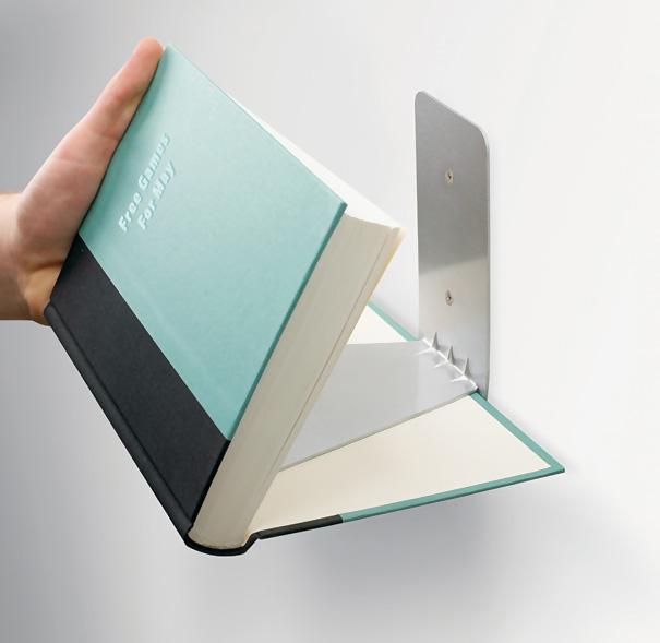 """Libros, """"pegados"""" a la pared mediante soportes de metal de diseñador Miron Lior. Estantes invisible soportar hasta 7 kg!"""