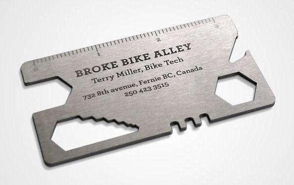 Визитная карточка в виде универсального ключа для велосипеда.