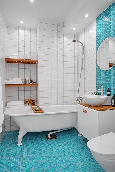 Малобюджетный позитивный интерьер небольшой шведской квартиры
