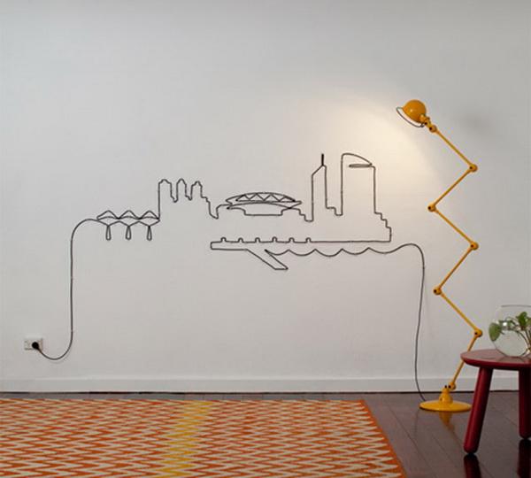 шнур от лампы в качестве настенного оформления