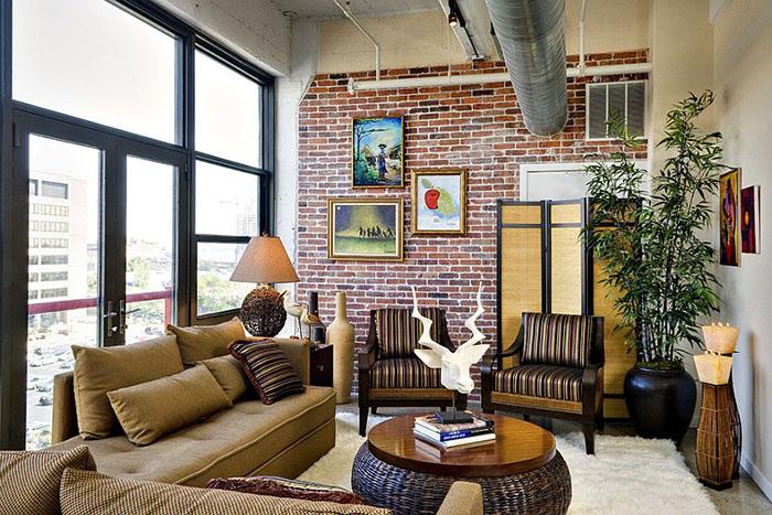 Интерьер стильной гостиной с кмрпичной стеной