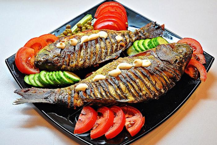 Рыба, запечённая с овощами.
