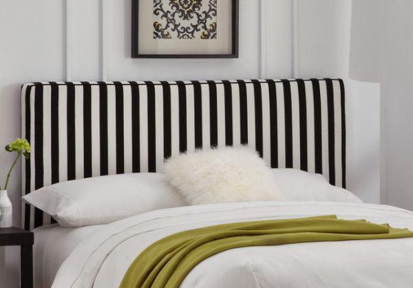 Полосатое изголовье кровати - оригинальный акцент в интерьере спальни