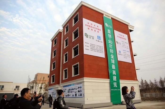 Китайская компания WinSun научилась печатать на принтере многоэтажные дома