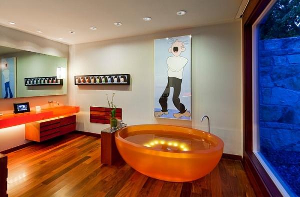 Модная оранжевая ванна круглой формы.