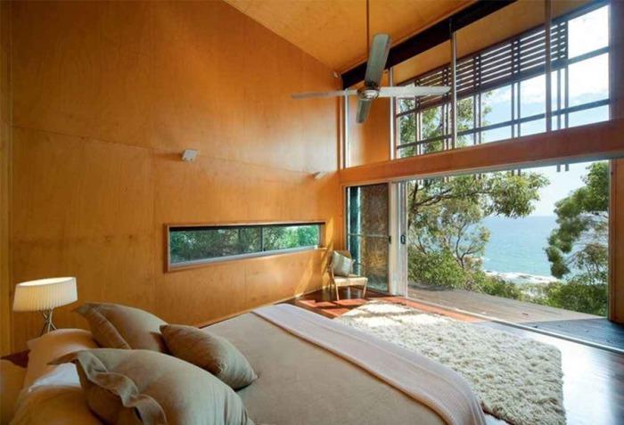 Alinghi Residence. Раздвижные двери стирают границы между внутренним помещением и ландшафтом.