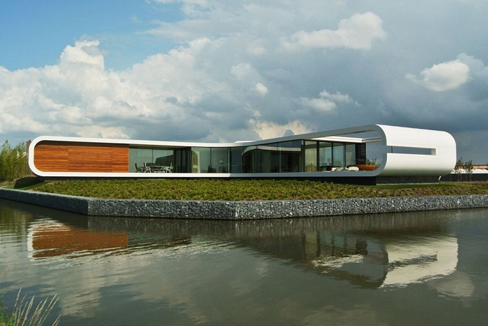 Villa New Water - г-образная вилла с обтекаемыми формами.