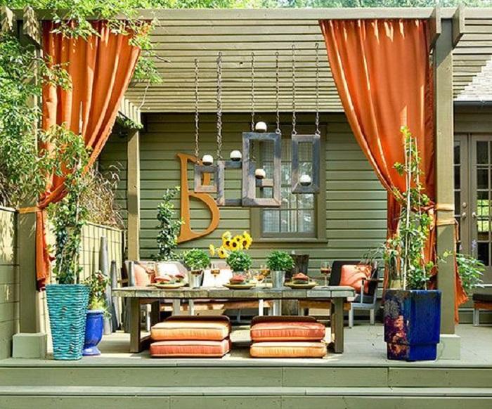 Сочетание оттенков оливкового и оранжевого создают особенно уютную атмосферу.