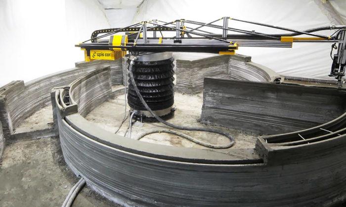 3D-принтер печатает дом.