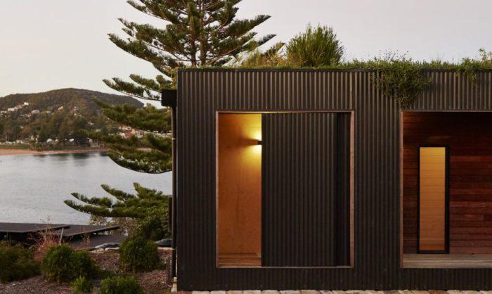 Avalon - модульный дом с зеленой крышей.