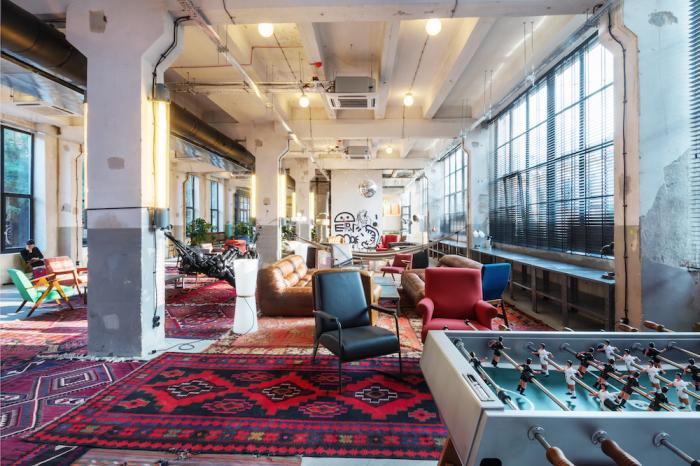 Архитекторы бюро Multiverse Architecture переделали бывшую фабрику в хостел и зону досуга.