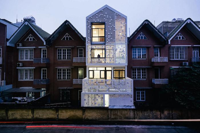 Cocoon House - жилой дом с перфорированным фасадом.