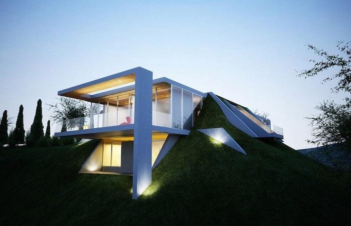 Асимметричная конструкция, интегрированная в земляной массив.