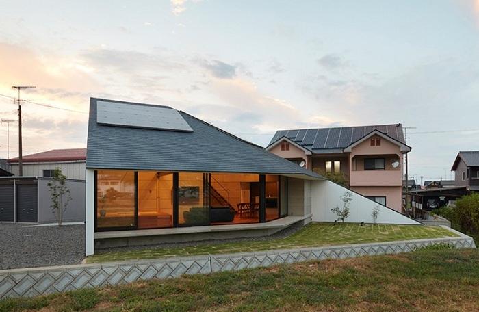 Жилой дом в форме веера.