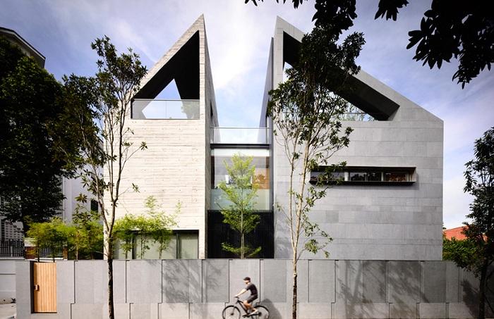 «66MRN House» - дом, разделенный на две части.
