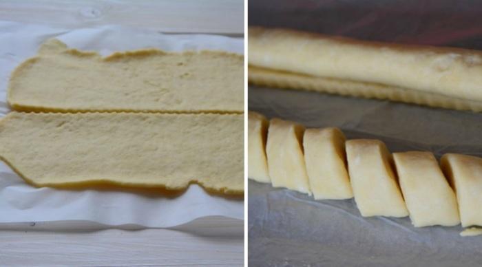 Скрутить раскатанное тесто в рулет.