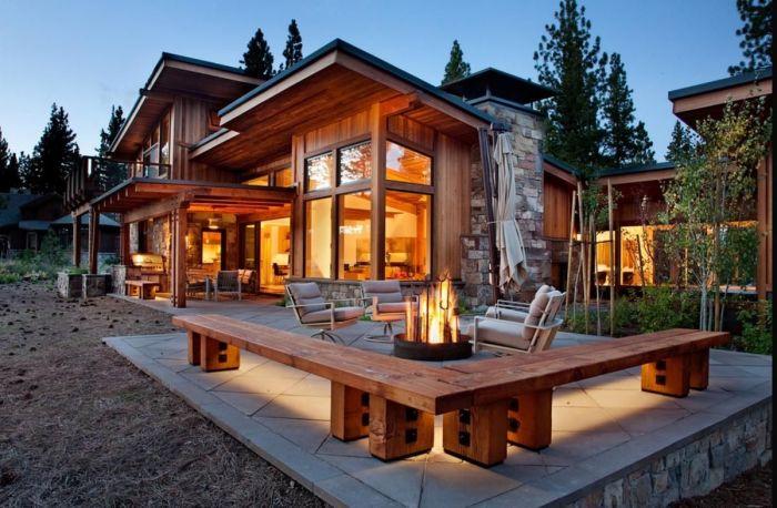 Дом, который сочетает в себе традиционный рустикальный стиль и хай-тек технологии.