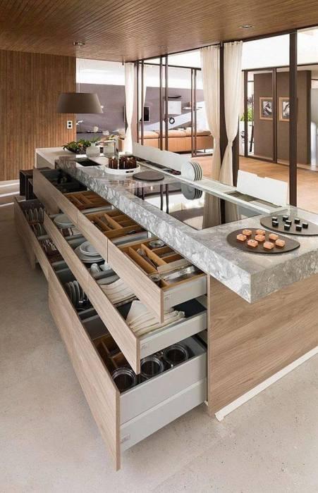 Многофункциональный кухонный остров является не только дополнительным рабочим местом на кухне, но и оригинальной системой хранения.