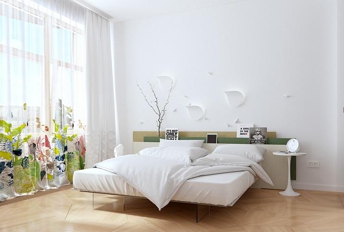 Просторная светлая спальная комната в классическом современном стиле.