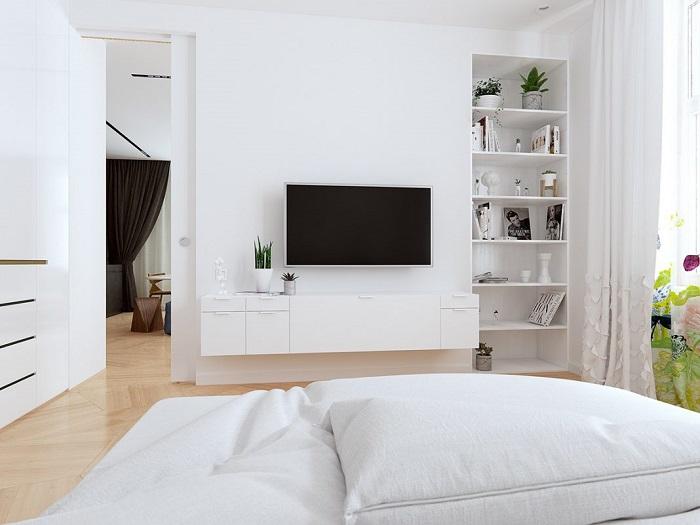 Светлая модульная стенка в интерьере спальной комнаты.