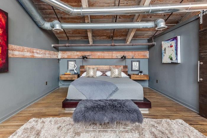 Спальная комната, в которых витает особый индустриальный шарм.