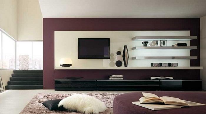 Модульная стенка, в которой сочетаются светлые и тёмные оттенки, впишется в любой классический интерьер гостиной комнаты.