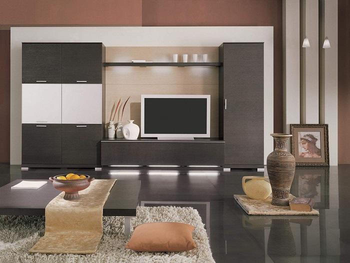 Серая модульная система может стать настоящей изюминкой в интерьере гостиной комнаты.