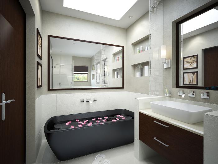 Маленькая светлая ванная комната, где ярким пятном выступает тёмно-серая ванна.