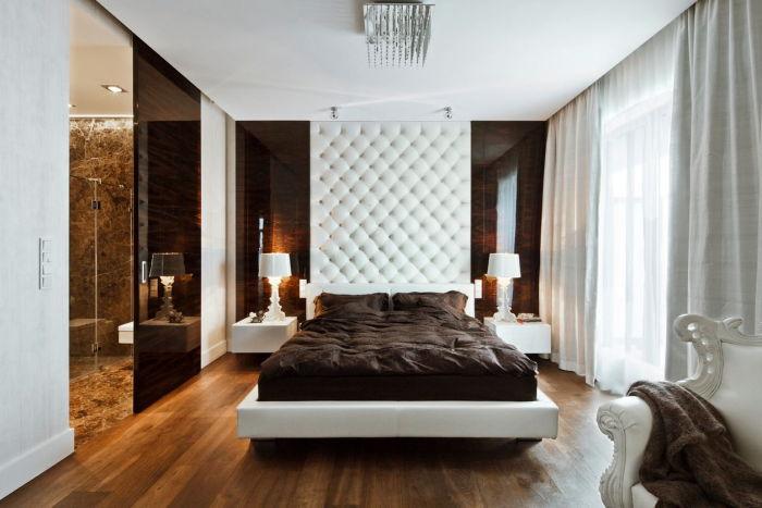 Аристократические мотивы в современном интерьере спальни, которые представлены в виде великолепной мебели в сочетании с натуральными отделочными материалами.