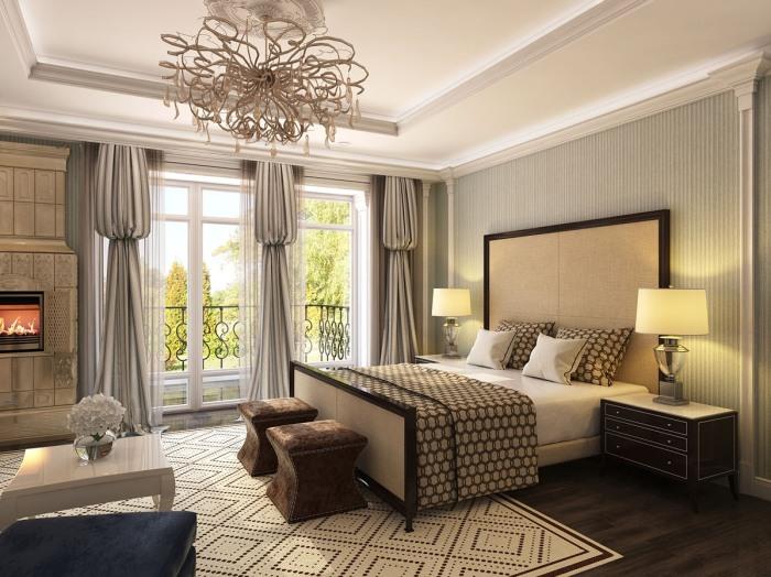 Песочные оттенки и коричневый цвет располагают к спокойствию и отдыху, а декоративный камин подчеркивает классический стиль помещения.