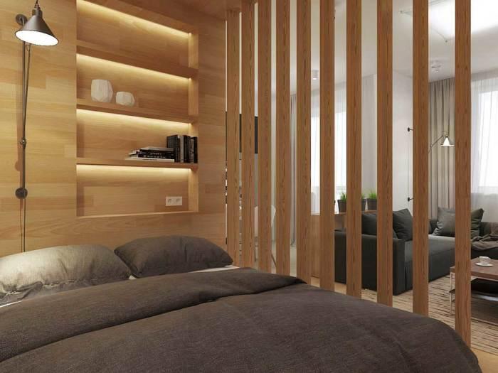 Панель из деревянных планок, которая позволит создать современный визуальный барьер в интерьере.