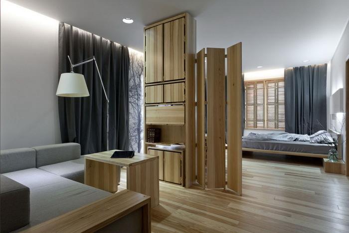 Деревянная перегородка в небольшом помещении - неотъемлемая часть большинства трендовых дизайнерских проектов.