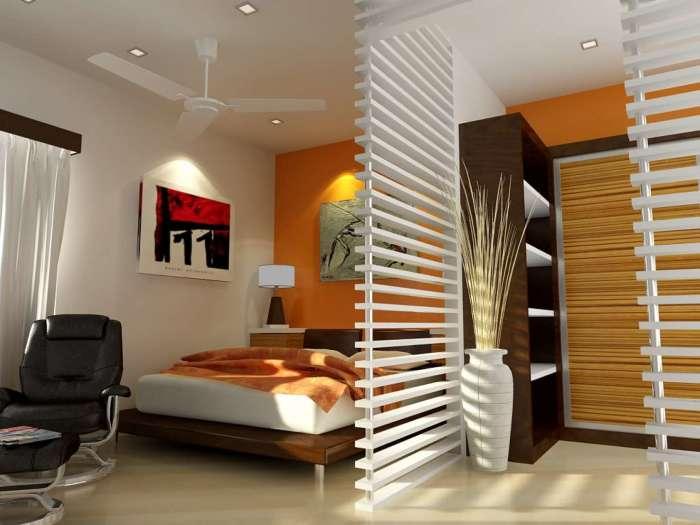 Перегородка в спальной комнате, которая благодаря полупрозрачной панели из деревянных реек создает необычную атмосферу.