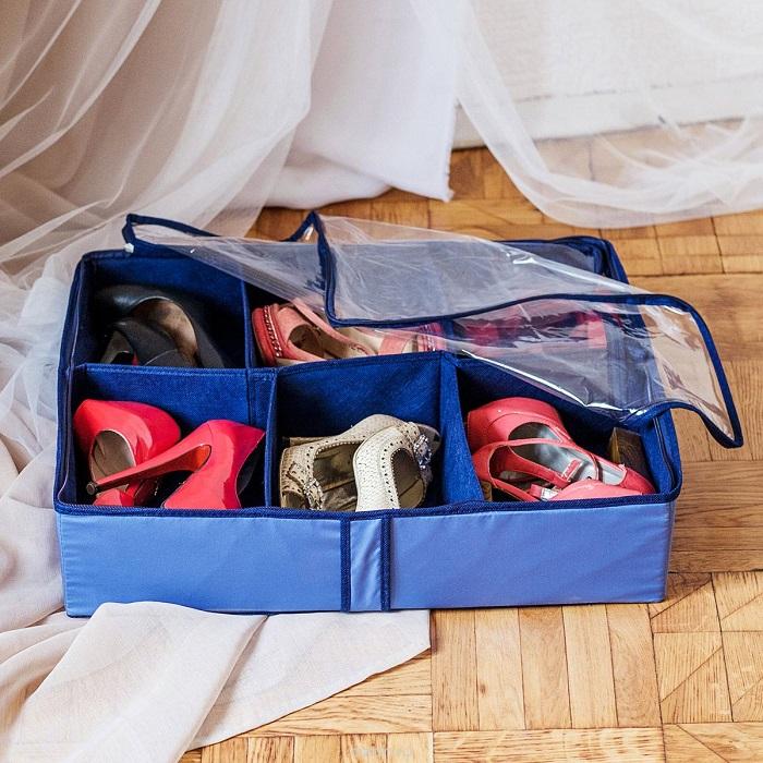 Старый чемодан для одежды можно использовать для хранения обуви.