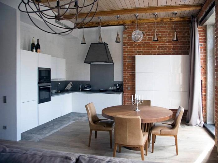 Неотделанная кирпичная стена или ее имитация отлично подойдет любителям минимализма.